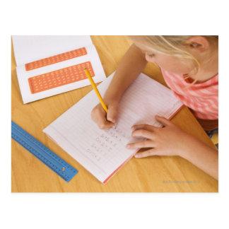 Girl doing homework postcard