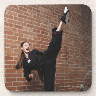 Girl doing martial arts 3 beverage coaster