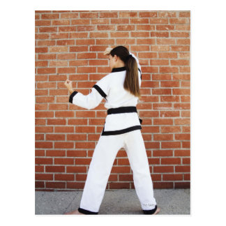 Girl doing martial arts postcard