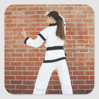 Girl doing martial arts square sticker