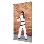 Girl doing martial arts stretched canvas prints