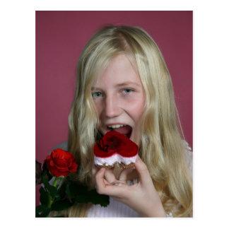 Girl eating a cake postcard