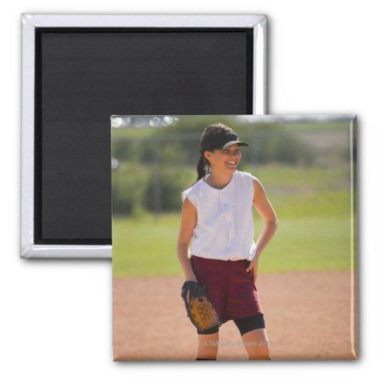 Girl enjoying playing baseball magnet