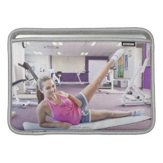 Girl Exercising in Gym MacBook Air Sleeves