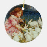 Girl feeding rabbites christmas tree ornaments