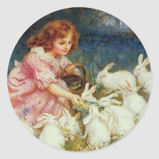 Girl feeding Rabbits Round Stickers