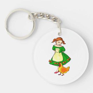 girl green dress standing chicken at feet keychain
