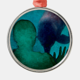 Girl hand up dolphins back grunged christmas ornaments