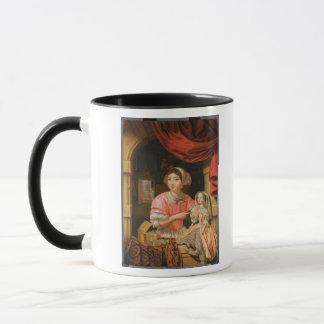 Girl holding a doll in an interior mug