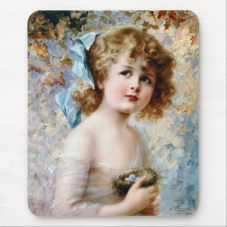 Girl holding a nest mouse pad