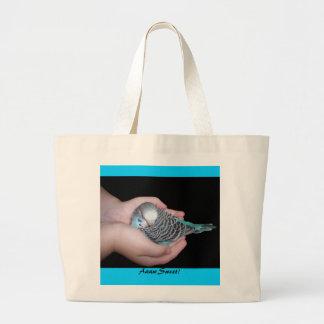 Girl holding baby budgie bag