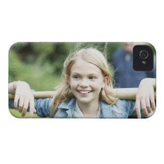Girl holding baseball bat iPhone 4 cover