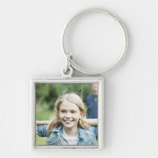 Girl holding baseball bat keychain