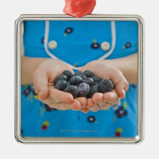 Girl holding fresh blueberries metal ornament