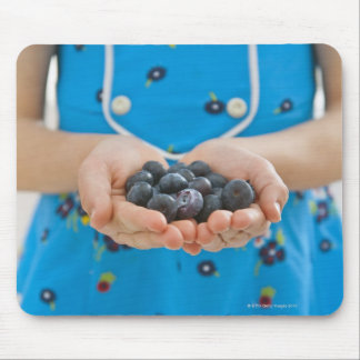 Girl holding fresh blueberries mouse pad