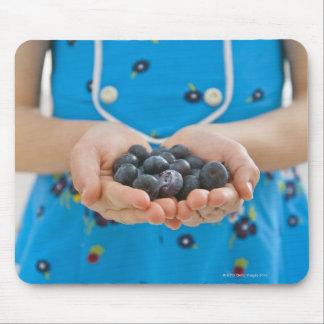 Girl holding fresh blueberries mouse pad