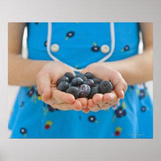 Girl holding fresh blueberries poster