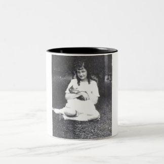 girl holding her cat mug