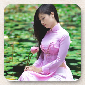 Girl holding lotus at the fountain beverage coaster