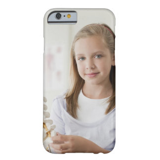 Girl holding model of spine in doctors office barely there iPhone 6 case