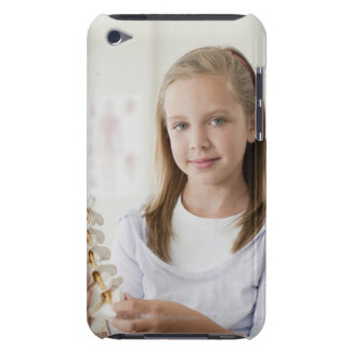 Girl holding model of spine in doctors office iPod touch case