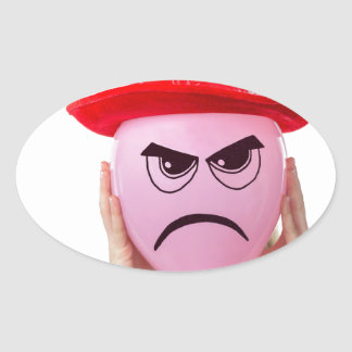 Girl holding pink balloon with angry face and hat oval sticker