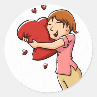 Girl hugging heart classic round sticker