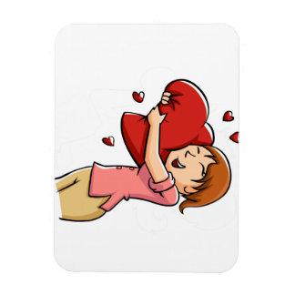 Girl hugging heart magnet