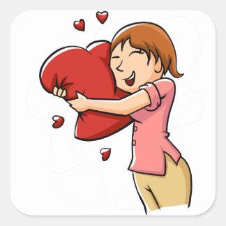 Girl hugging heart square sticker