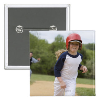 Girl in batting helmet running bases 2 inch square button