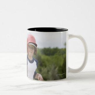 Girl in batting helmet running bases taza de café