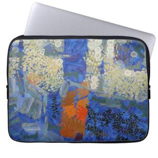 Girl in blue and orange walking by laptop sleeve