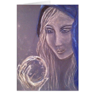 Girl in blue holding a crystal ball card