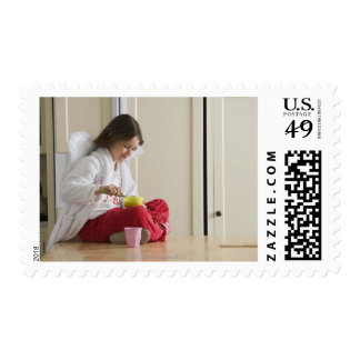 Girl in costume eating cereal stamp