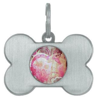 Girl in pink bikini and big heart pet ID tag