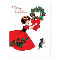 Girl in red dress with Christmas wreath and a cat Postcard