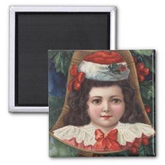 Girl in Santa Hat in Bell Magnet