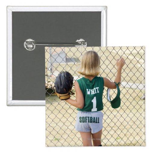 Girl in softball uniform pins