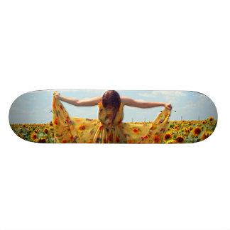 Girl in Sunflower Field Skateboard Deck