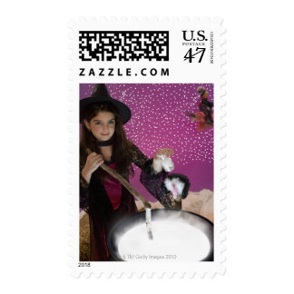 Girl in witch costume stirring cauldron postage