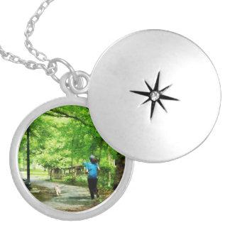 Girl Jogging with Dog Locket Necklace