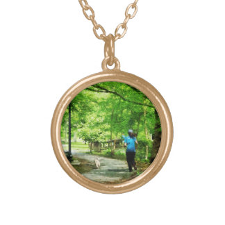 Girl Jogging with Dog Round Pendant Necklace