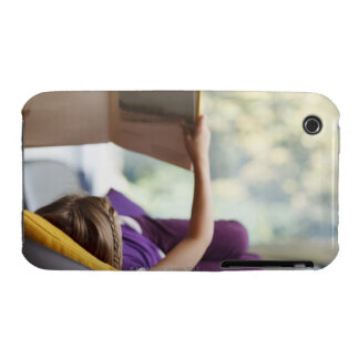 Girl laying down reading book iPhone 3 cases