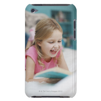 Girl laying in bed reading book barely there iPod cover