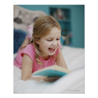 Girl laying in bed reading book posters
