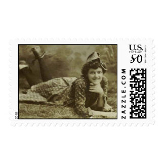 Girl laying on the grass postage