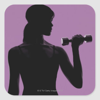 girl lifting dumbbell on purple background square sticker