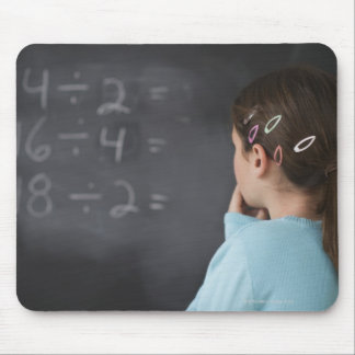 Girl looking at math equations on blackboard mouse pad