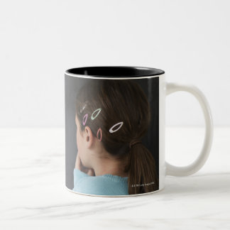 Girl looking at math equations on blackboard Two-Tone coffee mug