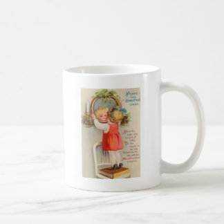 Girl Looking In Holly Covered Mirror Coffee Mug